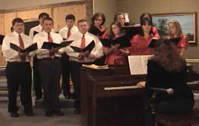 Deborah directing and playing a Christmas Program at a local church. Sing with me!